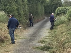 Work Party at the field to clear weeds in the lane 6